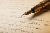 stock photo of fountains  - Fountain pen on an antique handwritten letter - JPG