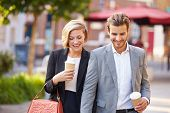pic of takeaway  - Business Couple Walking Through Park With Takeaway Coffee - JPG