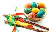picture of flogging  - Czech rod with Easter eggs on white background - JPG