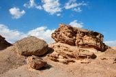 Scenic weathered orange rock in stone desert poster
