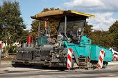 picture of paving  - asphalt paving machine at construction sito on a street - JPG