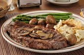 pic of sauteed  - A grilled rib steak with sauteed mushrooms asparagus and mashed potatoes - JPG