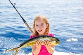stock photo of mahi  - Blond kid girl fishing Dorado Mahi - JPG