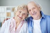 picture of sweethearts  - Portrait of cheerful seniors looking at camera with smiles - JPG