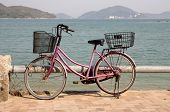 picture of lantau island  - Old bycicle on the quay of Lantau Island Hong Kong - JPG