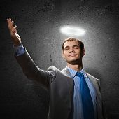 pic of halo  - Young handsome businessman with halo above head - JPG