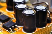 pic of capacitor  - Macro of black capacitors from circuit board - JPG