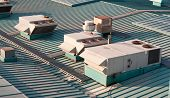 picture of air conditioner  - Air vents on top of a commercial building - JPG
