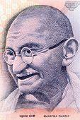 pic of mahatma gandhi  - Close up shot of Gandhi on Indian rupee note - JPG