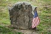 image of revolutionary war  - Revolutionary War Hero Grave Site with an American Flag - JPG