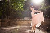 pic of adults only  - Young beautiful ballerina with pink dress dancing. Outdoor portrait