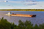 image of barge  - Old barge floating up the river Northern Dvina - JPG
