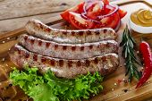 image of grilled sausage  - grilled sausages on the grill on the board - JPG