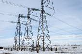 image of power transmission lines  - Power transmission line and constructions in winter - JPG