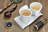 pic of spyglass  - Vintage Spyglass Magnifying Glass Compass Smoking Pipe and Two Espresso Coffee Cups On The Grunge Wooden Table - JPG