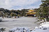 stock photo of shogun  - a golden zen temple during winter time - JPG