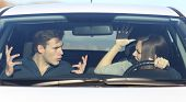 stock photo of dangerous situation  - Couple arguing while she is driving a car in a dangerous situation - JPG