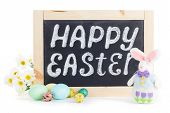 stock photo of hare  - Happy Easter chalkboard with cute hare and painted eggs - JPG
