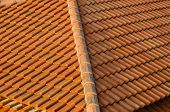 stock photo of roof tile  - Roof tiles made of natural material background - JPG