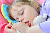 stock photo of suck  - Sleeping little cute baby girl sucking her thumb - JPG