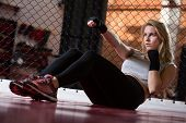 stock photo of crunch  - Athletic woman warming up and doing crunches - JPG