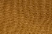 picture of knitting  - close up of a rust colored knitted background pattern, detail, knitted right, full frame ** Note: Visible grain at 100%, best at smaller sizes - JPG