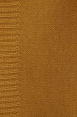 image of knitting  - close up of a rust colored knitted background pattern, knitted right and left, detail, vertical ** Note: Visible grain at 100%, best at smaller sizes ** Note: Soft Focus at 100%, best at smaller sizes - JPG