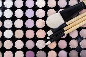 foto of face-powder  - brushes and shadows from the face makeup - JPG