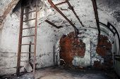 stock photo of ww2  - Old empty abandoned bunker interior with white walls and rusted constructions - JPG
