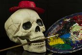 foto of eye-sockets  - Skull with a paint brush and oil paints - JPG