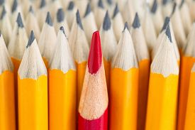 foto of pencils  - Close up front image of stacked pencils with focus on tip of red pencil in middle of the stack - JPG