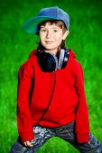 foto of 7-year-old  - Portrait of cute7 years old boy outdoor - JPG