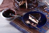 foto of icing  - Delicious chocolate cake with icing in plate on table - JPG