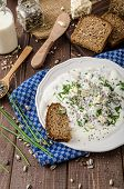 foto of whole-wheat  - Homemade yogurt dip with blue cheese and chives whole wheat bread and milk for bio healthy food - JPG