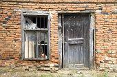 image of windows doors  - Old wooden door and window on abandoned home Bulgaria Europe - JPG