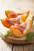 stock photo of cantaloupe  - cantaloupe melon with prosciutto - JPG