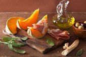 stock photo of cantaloupe  - cantaloupe melon with prosciutto grissini olives - JPG