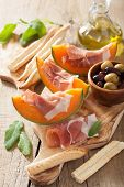 foto of cantaloupe  - cantaloupe melon with prosciutto grissini olives - JPG