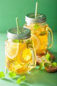 stock photo of mason  - ice tea with lemon and melissa in mason jars - JPG
