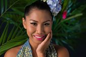 image of filipina  - Portrait of beautiful smiling girl against palm trees - JPG