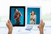image of tin can phone  - Photos on digital tablets with young Asian man using a tin phone to sing a song for his girlfriend - JPG