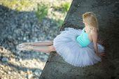 pic of tutu  - Ballerina sitting on the edge of the bridge - JPG