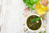 stock photo of pesto sauce  - Homemade green basil pesto sauce and fresh ingredients - JPG