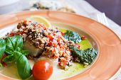 stock photo of halibut  - Baked halibut with vegetable garnish and couscous - JPG