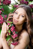 picture of allergies  - Young spring fashion woman in spring garden Springtime Summertime Trendy girl in the flowering trees in then at sunset in spring summer landscape background Allergic to pollen of flowers Allergy  - JPG