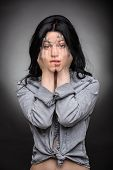 picture of exposition  - Multi exposition brunette portrait that covers face with his hands translucent in the emotion of surprise and doubt - JPG