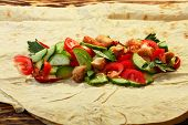 picture of shawarma  - Traditional shawarma with chicken and vegetables in unwrapped condition - JPG
