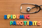 picture of epidemic  - epidemic parotiditis colorful medical word and stethoscope on the wooden background - JPG