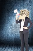 stock photo of anonymous  - Anonymous businesswoman holding a megaphone against dark grey room - JPG
