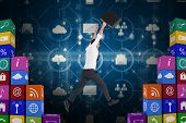 image of leaping  - Businessman leaping with his briefcase against app wall - JPG